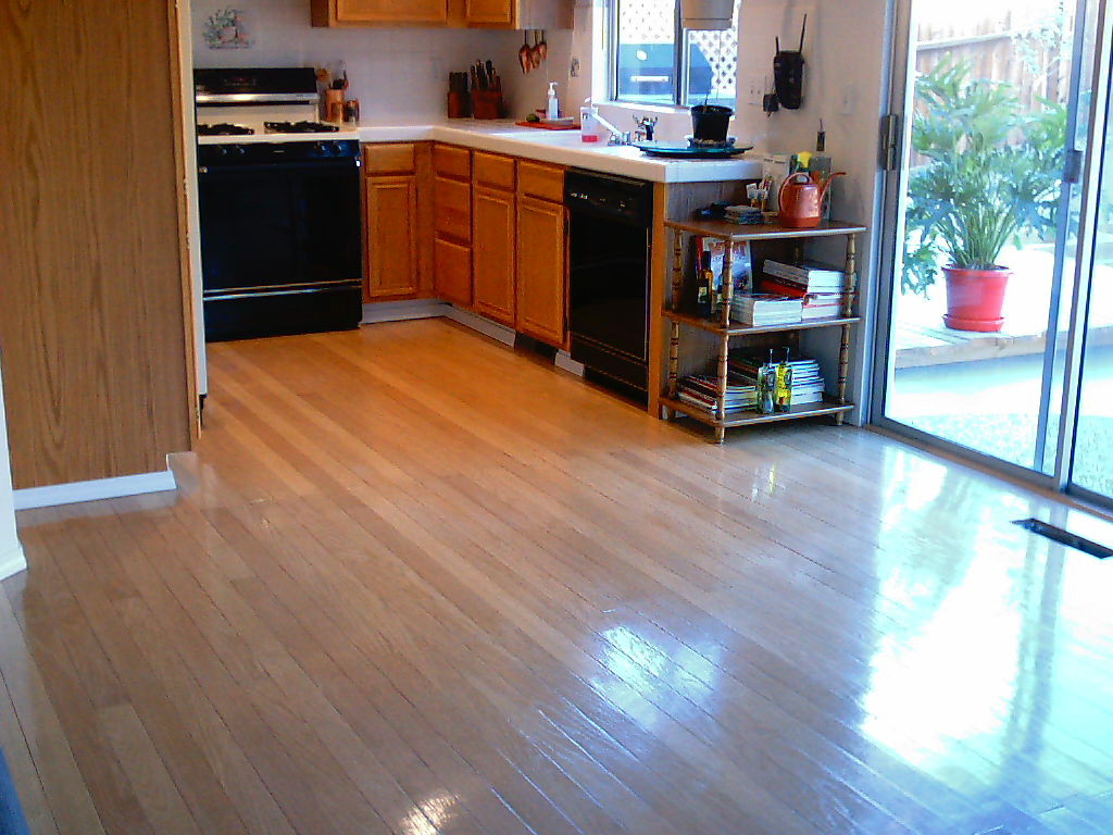 Laminate flooring pergo laminate flooring in kitchen for Kitchen laminate flooring
